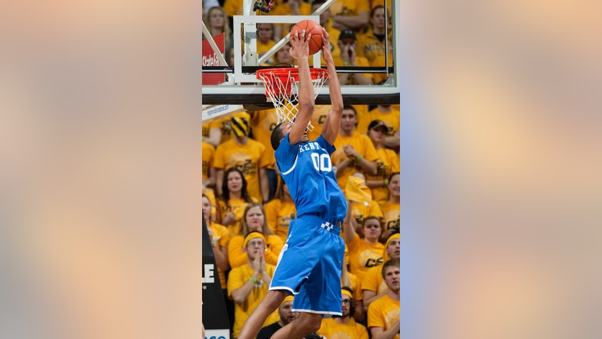 Kentucky's Marcus Lee dunks the ball behind his back during the first half of an NCAA college basketball game against Missouri Saturday, Feb. 1, 2014, in Columbia, Mo. (AP Photo/L.G. Patterson)