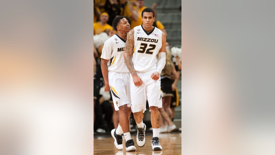 Missouri's Jabari Brown, right, is congratulated by teammate Wes Clark, left, after Brown made a 3-point shot during the second half of an NCAA college basketball game against Kentucky Saturday, Feb. 1, 2014, in Columbia, Mo. Brown had a game-high 33 points in Kentucky's 84-79 victory. (AP Photo/L.G. Patterson)