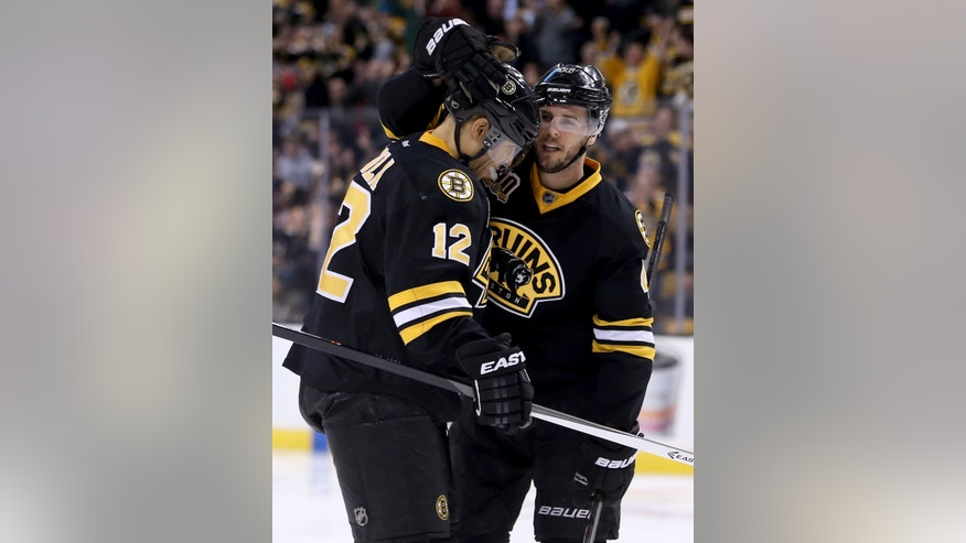 Boston Bruins center David Krejci, right, of Czech Republic, is congratulated by teammate right wing Jarome Iginla (12) after scoring a goal during the second period of an NHL hockey game against the Edmonton Oilers, Saturday, Feb. 1, 2014 in Boston. (AP Photo/Mary Schwalm)