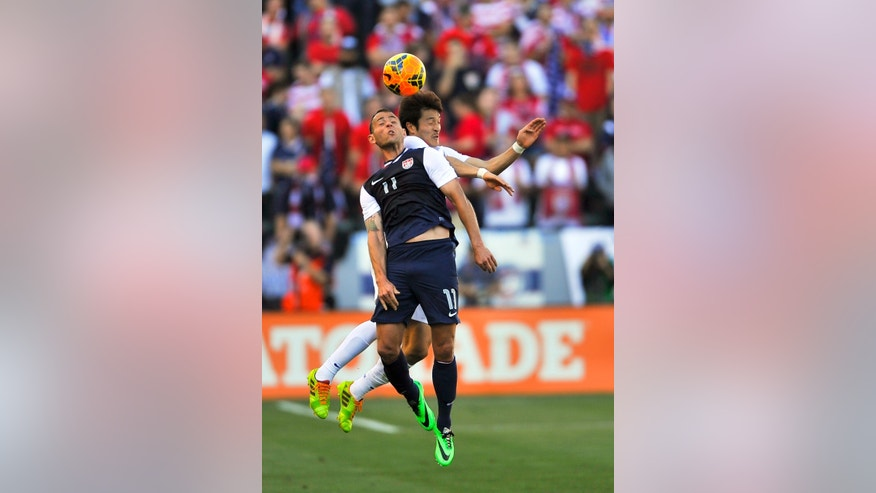 South Korea midfielder Park Jong-Woo, back right, and United States midfielder Brad Davis (11) battle for a head ball during the first half of an international friendly soccer match in Carson, Calif., Saturday, Feb. 1, 2014. (AP Photo/Gus Ruelas)