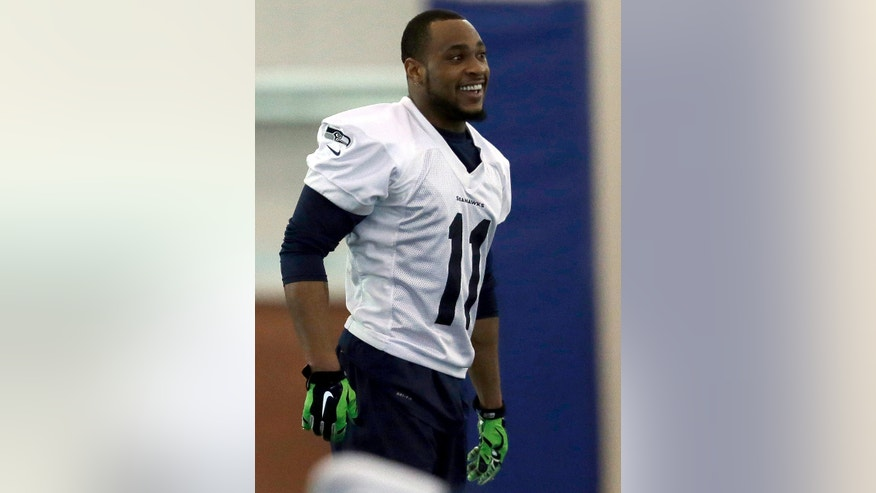 Seattle Seahawks wide receiver Percy Harvin smiles as he warms up at the start of NFL football practice Wednesday, Jan. 29, 2014, in East Rutherford, N.J. The Seahawks and the Denver Broncos are scheduled to play in the Super Bowl XLVIII football game Sunday, Feb. 2, 2014. (AP Photo/Jeff Roberson)