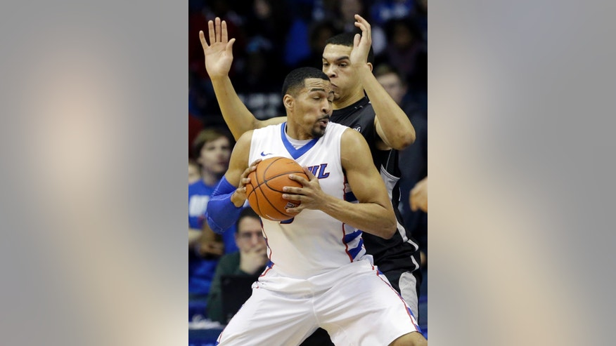 DePaul forward DeJuan Marrero, front, drives against Providence forward Tyler Harris during the first half of an NCAA college basketball game in Rosemont, Ill., on Saturday, Feb. 1, 2014. (AP Photo/Nam Y. Huh)