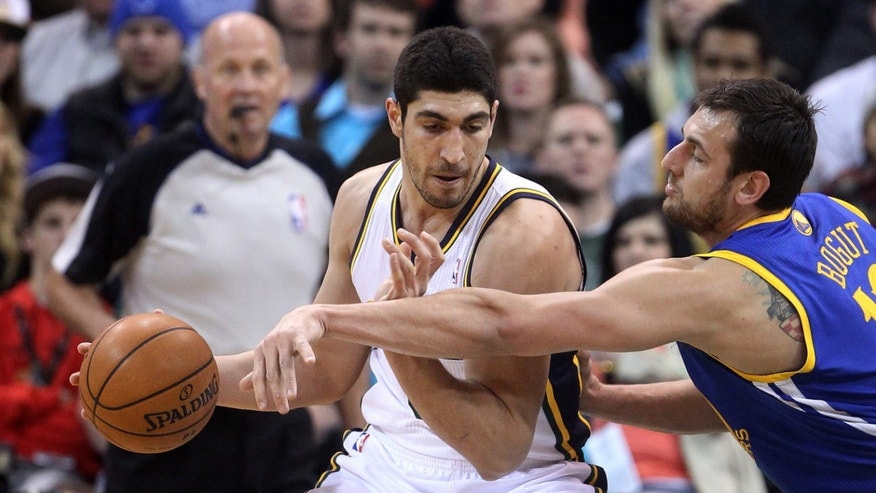 Golden State Warriors' Andrew Bogut, right defends against Utah Jazz's Enes Kanter, left, in the first quarter of an NBA basketball game, Friday, Jan. 31, 2014, in Salt Lake City. (AP Photo/Rick Bowmer)