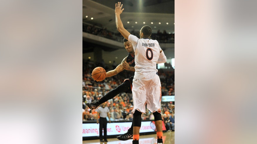 Georgia guard Charles Mann (4) passes the ball around Auburn center Asauhn Dixon-Tatum (0) during an NCAA college basketball game Saturday, Feb. 1, 2014, at Auburn Arena in Auburn, Ala. (AP Photo/AL.com, Julie Bennett) MAGS OUT