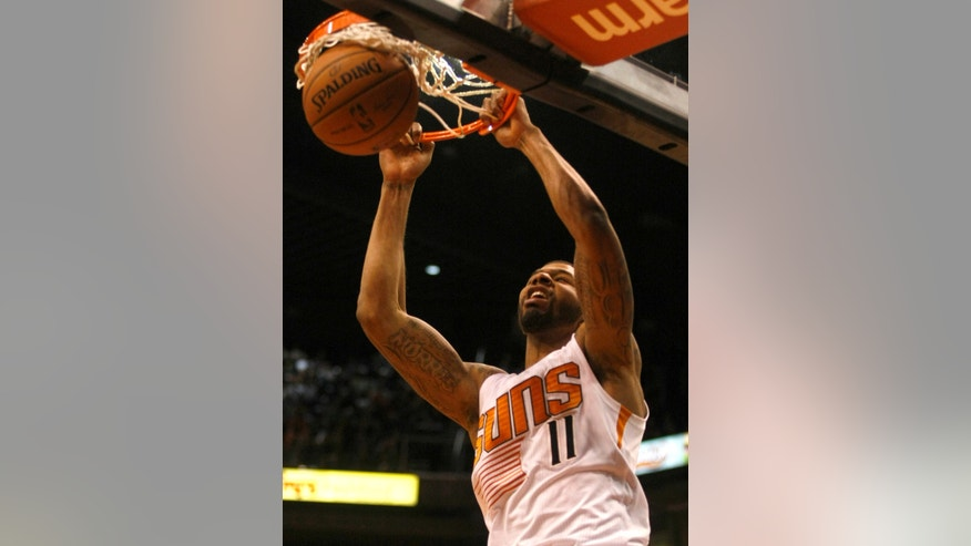 Phoenix Suns power forward Markieff Morris (11) dunks in the third quarter during an NBA basketball game against the Charlotte Bobcats, Saturday, Feb. 1, 2014, in Phoenix. (AP Photo/Rick Scuteri)