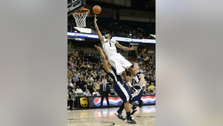 Wake Forest's Madison Jones, right, drives to the basket over Georgia Tech's Corey Heyward, left, during the first half of an NCAA college basketball game in Winston-Salem, N.C., Saturday, Feb. 1, 2014. (AP Photo/Chuck Burton)