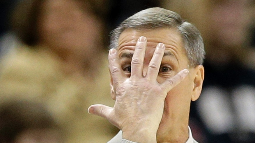 Wake Forest head coach Jeff Bzdelik directs his team against Georgia Tech during the first half of an NCAA college basketball game in Winston-Salem, N.C., Saturday, Feb. 1, 2014. (AP Photo/Chuck Burton)
