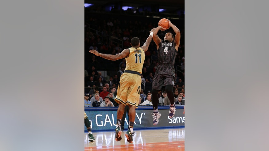 Georgetown's D'Vauntes Smith-Rivera (4) shoots over Michigan State's Keith Appling (11) during the first half of an NCAA basketball game Saturday, Feb. 1, 2014, in New York. (AP Photo/Frank Franklin II)