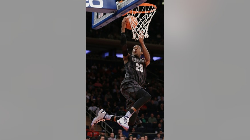 Georgetown's Aaron Bowen (23) scores during the first half of an NCAA basketball game against Michigan State Saturday, Feb. 1, 2014, in New York. (AP Photo/Frank Franklin II)