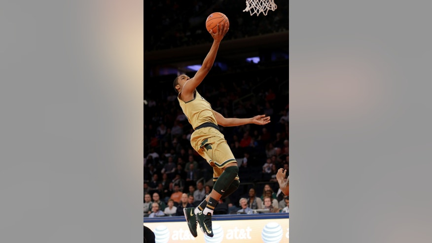 Michigan State's Alvin Ellis III scores during the first half of an NCAA basketball game against Georgetown at Madison Square Garden, Saturday, Feb. 1, 2014, in New York. (AP Photo/Seth Wenig)