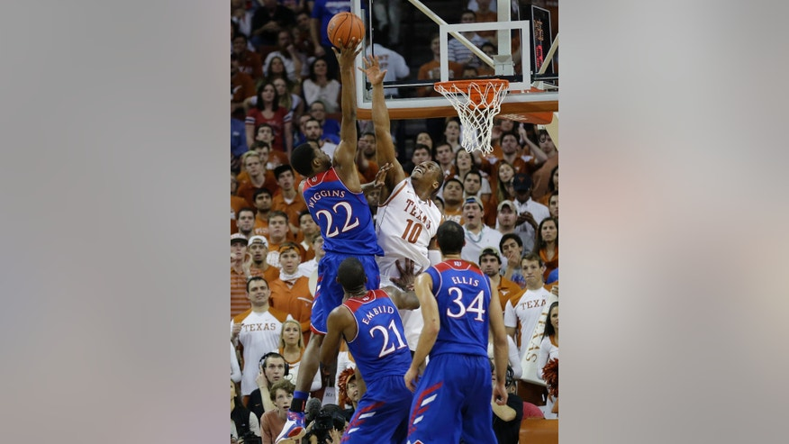 Kansas' Andrew Wiggins (22) shoots as Texas' Jonathan Holmes (10) defends during the first half of an NCAA college basketball game, Saturday, Feb. 1, 2014, in Austin, Texas. (AP Photo/Eric Gay)