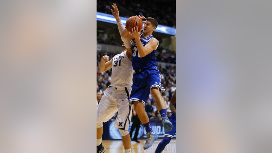 Seton Hall guard Jaren Sina (30) comes down with a rebound against Xavier forward Isaiah Philmore (31) during the first half of an NCAA college basketball game, Saturday, Feb. 1, 2014, in Cincinnati. (AP Photo/David Kohl)