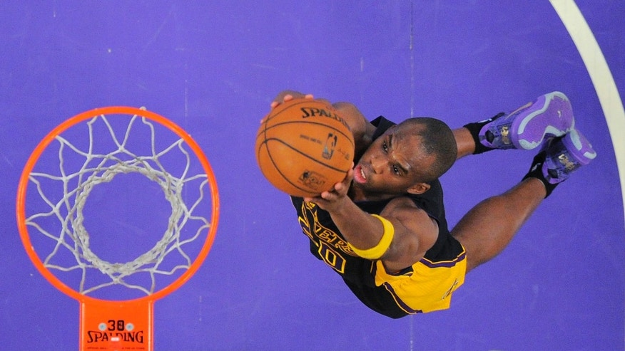 Los Angeles Lakers guard Jodie Meeks goes up for a dunk during the first half of an NBA basketball game against the Charlotte Bobcats, Friday, Jan. 31, 2014, in Los Angeles. (AP Photo/Mark J. Terrill)