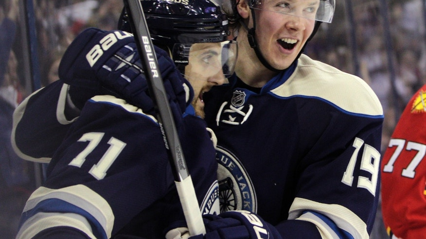 Columbus Blue Jackets' Nick Foligno, left, celebrates his goal against the Florida Panthers with teammate Ryan Johansen during the second period of an NHL hockey game on Saturday, Feb. 1, 2014, in Columbus, Ohio. (AP Photo/Jay LaPrete)