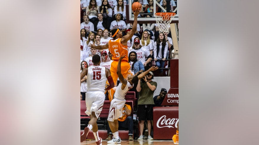 Tennessee forward Jarnell Stokes (5) towers over Alabama guard Trevor Releford (12) during an NCAA college basketball game Saturday, Feb. 1, 2014, in Tuscaloosa, Ala. Tennessee won 76-59. (AP Photo/Alabama Media Group, Vasha Hunt) MAGS OUT