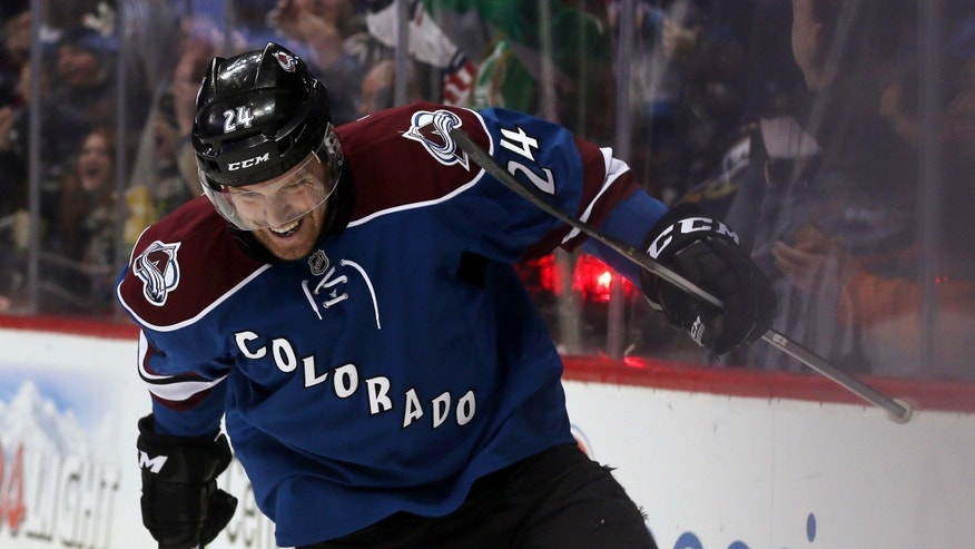Colorado Avalanche center Marc-Andre Cliche celebrates after scoring his first goal in the NHL on a redirected shot against the Buffalo Sabres in the second period of an NHL hockey game in Denver, Saturday, Feb. 1, 2014. (AP Photo/David Zalubowski)