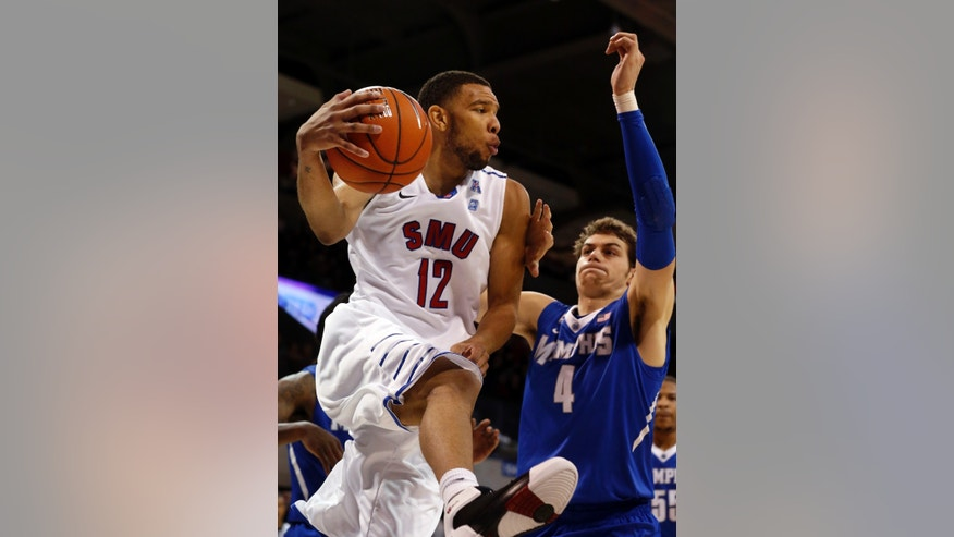 SMU guard Nick Russell (12) crosses under the basket as Memphis forward Austin Nichols (4) tries to cut him off during the first half of an NCAA college basketball game on Saturday, Feb. 1, 2014, in Dallas.  (AP Photo/John F. Rhodes)