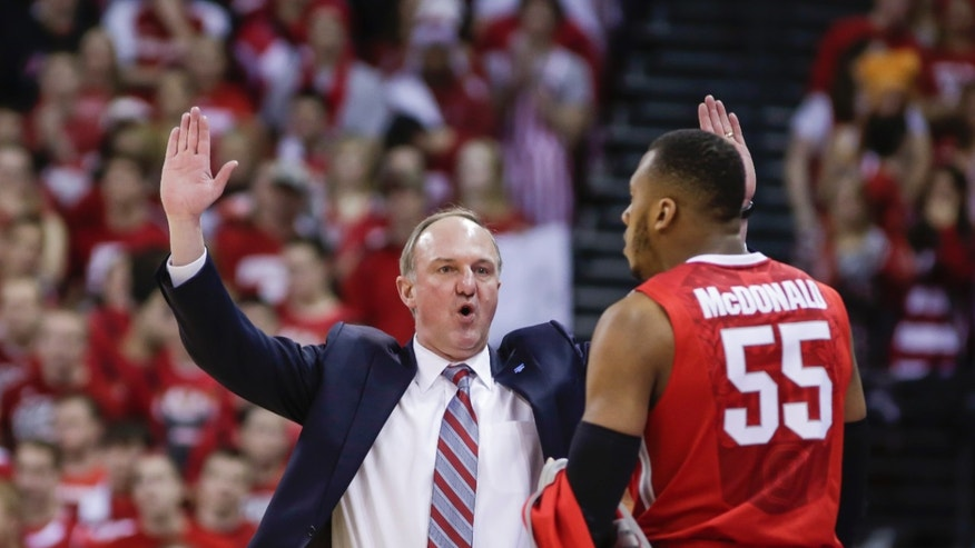 Ohio State coach Thad Matta talks with Trey McDonald during the first half of an NCAA college basketball game against Wisconsin Saturday, Feb. 1, 2014, in Madison, Wis. Ohio State upset Wisconsin, 59-58. (AP Photo/Andy Manis)