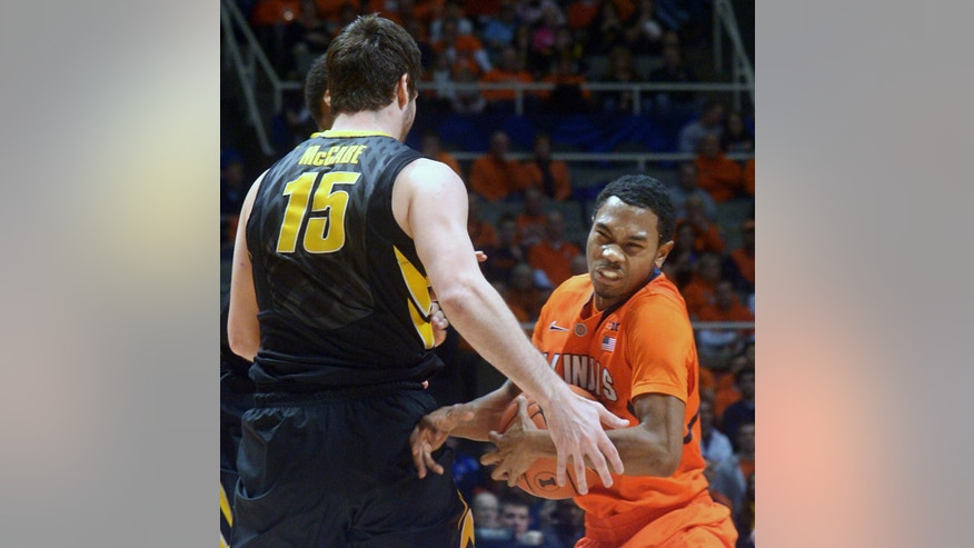 Illinois' Jaylon Tate (1) tries to keep the ball away from Iowa's Zach McCabe (15) during an NCAA college basketball game in Champaign, Ill., Saturday, Feb. 1, 2014. (AP Photo/Robin Scholz)