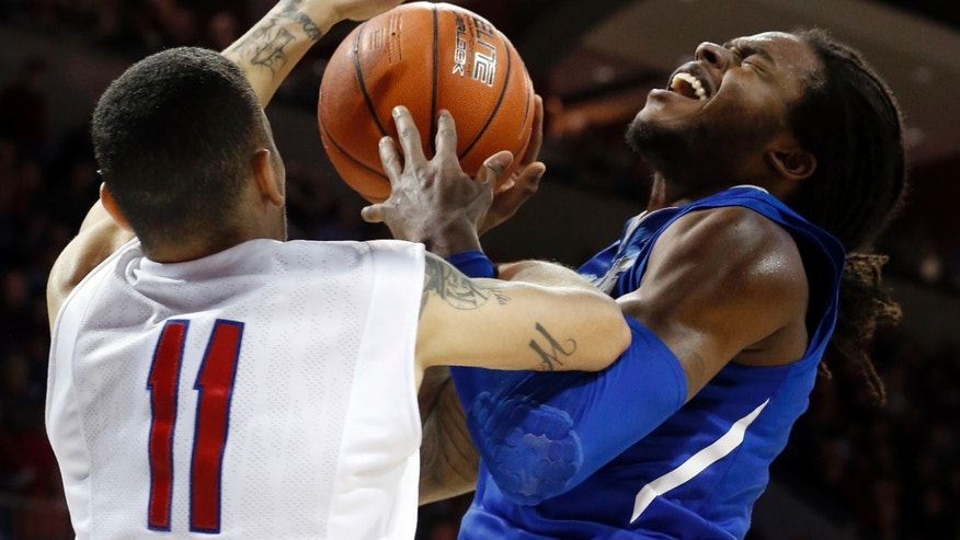 SMU guard Nic Moore (11) and Memphis forward Shaq Goodwin (2) battle for a rebound during the second half of a basketball game on Saturday, Feb. 1, 2014, in Dallas. SMU won 87-72. (AP Photo/John F. Rhodes)