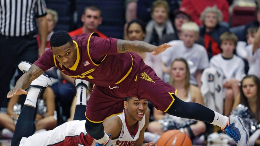 Arizona State guard Jahii Carson, top, goes after the ball as Stanford guard/forward Anthony Brown, bottom, looks on during the first half of their NCAA college basketball game Saturday, Feb. 1, 2014, in Stanford, Calif. (AP Photo/Eric Risberg)