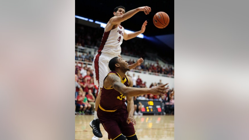 Arizona State guard Jermaine Marshall, bottom, goes to the basket but is blocked by Stanford center Stefan Nastic, top, during the first half of their NCAA college basketball game Saturday, Feb. 1, 2014, in Stanford, Calif. (AP Photo/Eric Risberg)
