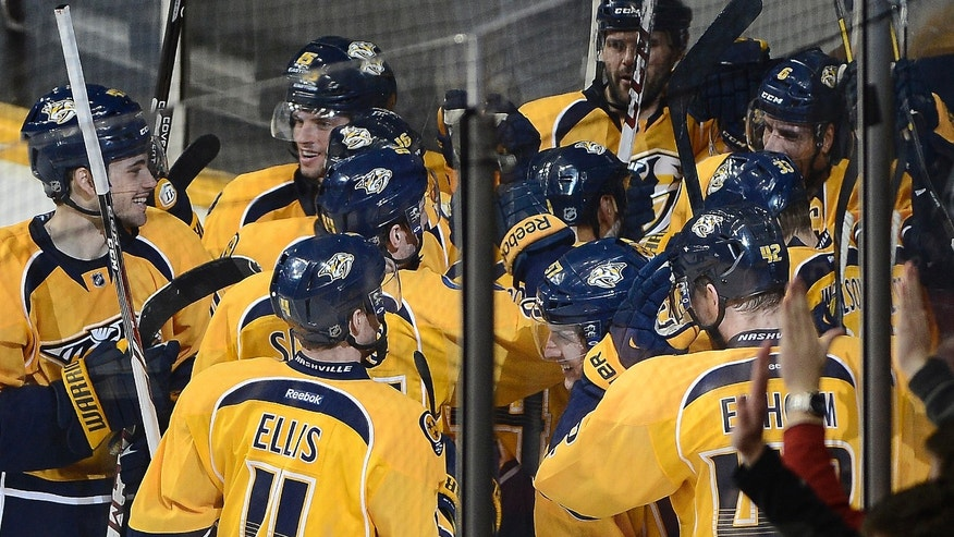 Nashville Predators defenseman Shea Weber (6), upper right, celebrates with his team after scoring the winning goal in overtime against the New Jersey Devils at an NHL hockey game on Friday, Jan. 31, 2014, in Nashville, Tenn. (AP Photo/Mark Zaleski)