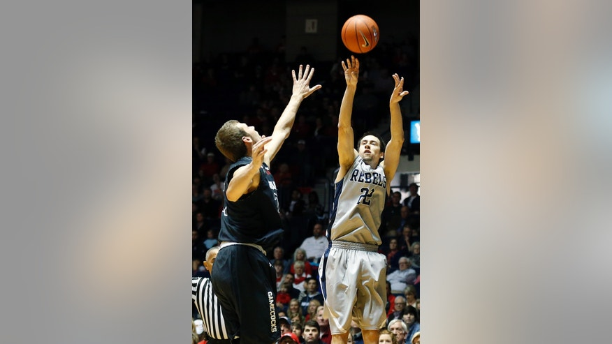 Mississippi guard Marshall Henderson (22) shoots as a South Carolina player defends in the first half of an NCAA college basketball game in Oxford, Miss., Saturday, Feb. 1, 2014. (AP Photo/Rogelio V. Solis)