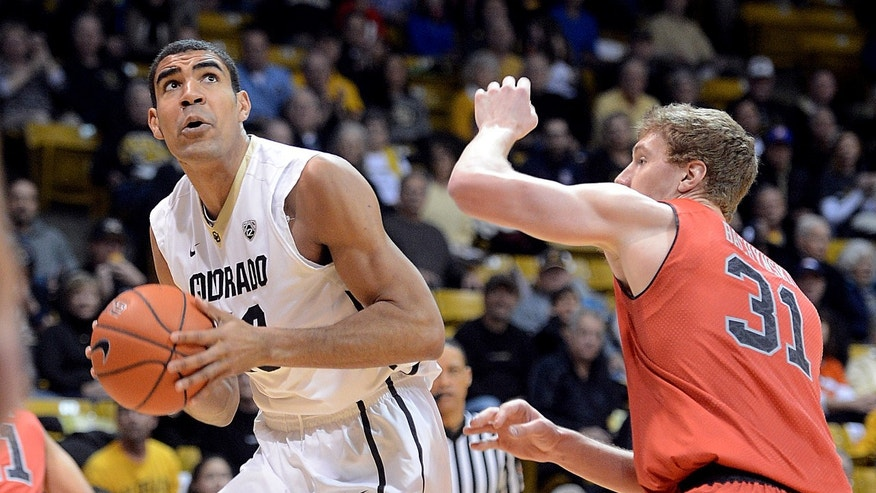 Colorado's Josh Scott, left, looks to shoot as Utah;s Dallin Bachynski defends during the first half of an NCAA college basketball game Saturday, Feb. 1, 2014, in Boulder, Colo. (AP Photo/The Daily Camera, Cliff Grassmick) NO SALES