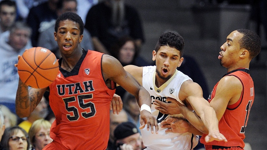 Utah's Delon Wright (55) works the ball past Colorado's Askia Booker, center, as Utah's Brandon Taylor sets a pick during the first half of an NCAA college basketball game Saturday, Feb. 1, 2014, in Boulder, Colo. (AP Photo/The Daily Camera, Cliff Grassmick) NO SALES