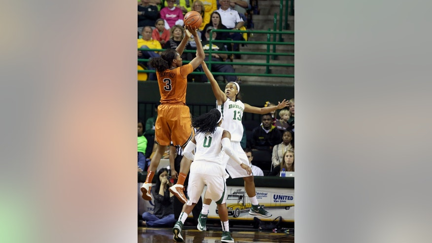 Texas forward Nneka Enemkpali (3) shoots over Baylor guard Odyssey Sims (0) and Nina Davis (13) in the first half of an NCAA college basketball game, Saturday, Feb. 1, 2014, in Waco, Texas. (AP Photo/The Waco Tribune-Herald, Rod Aydelotte)