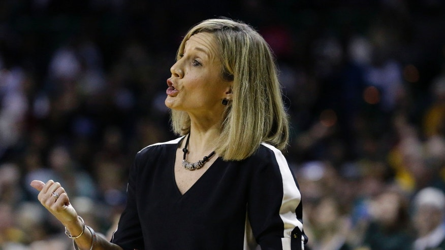 Texas head coach Karen Aston makes gestures from the sideline during the first half of an NCAA college basketball game against Baylor, Saturday, Feb. 1, 2014, in Waco, Texas. (AP Photo/LM Otero)