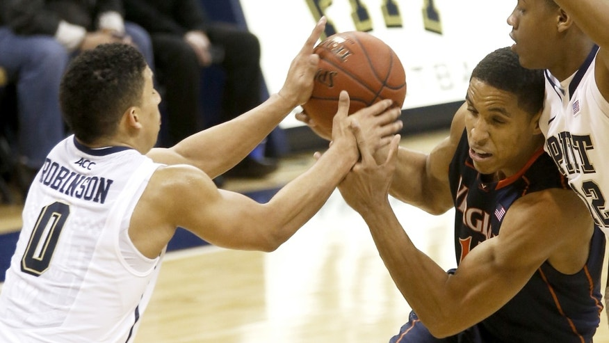 Pittsburgh's James Robinson (0) and Pittsburgh's Chris Jones, right, defend as Virginia's Malcolm Brogdon, center,  drives to the hoop during the second half of an NCAA college basketball game on Sunday, Feb. 2, 2014, in Pittsburgh. A dual possession was called on the play. (AP Photo/Keith Srakocic)