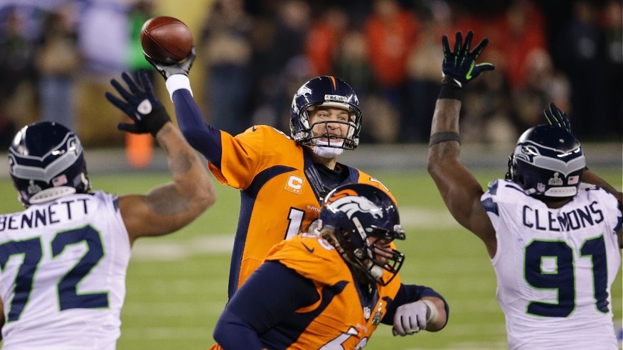 Denver Broncos' Peyton Manning throws against the Seattle Seahawks during the second half of the NFL Super Bowl XLVIII football game Sunday, Feb. 2, 2014, in East Rutherford, N.J. (AP Photo/Chris O'Meara)
