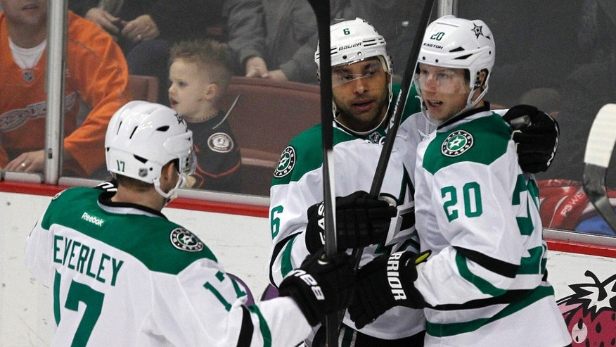 Dallas Stars' Rich Peverley (17) and Cody Eakin (20) congratulate Trevor Daley, left, who scored against the Anaheim Ducks in the second period of an NHL hockey game Saturday, Feb. 1, 2014, in Anaheim, Calif. (AP Photo/Alex Gallardo)