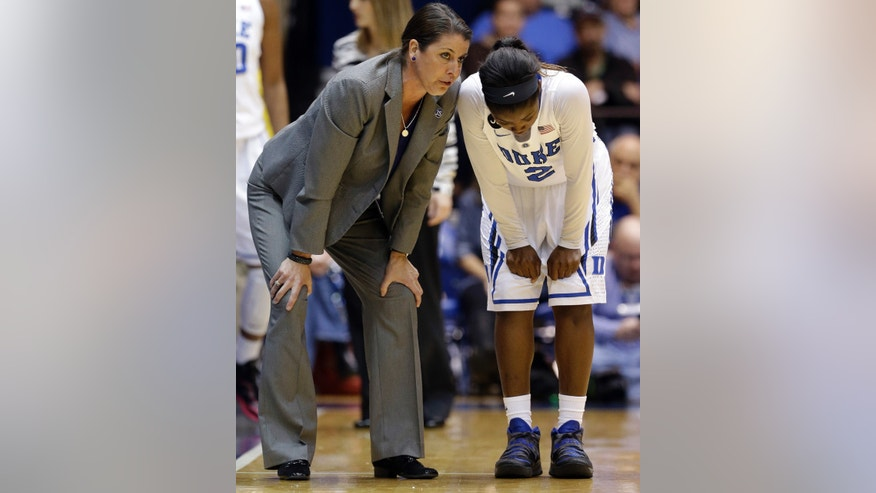 Duke coach Joanne P. McCallie, left, speaks with Alexis Jones during the second half of an NCAA college basketball game against Notre Dame in Durham, N.C., Sunday, Feb. 2, 2014. Notre Dame won 88-67. (AP Photo/Gerry Broome)