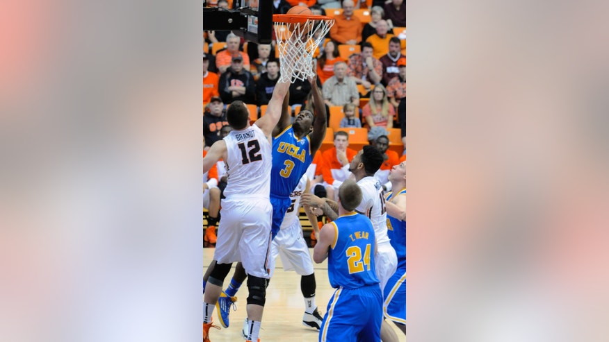 UCLA's Jordan Adams (3) shoots against Oregon State's Angus Brandt (12) during the first half of an NCAA college basketball game in Corvallis, Ore., Sunday, Feb. 2, 2014. (AP Photo/Greg Wahl-Stephens)
