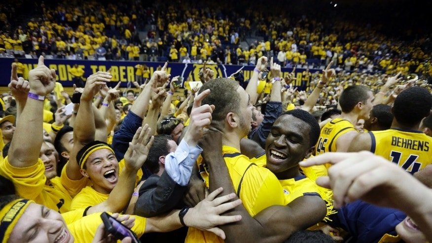 California players and fans celebrate after a win over Arizona during the second half on an NCAA college basketball game on Saturday, Feb. 1, 2014, in Berkeley, Calif. California won 60-58. (AP Photo/Marcio Jose Sanchez)