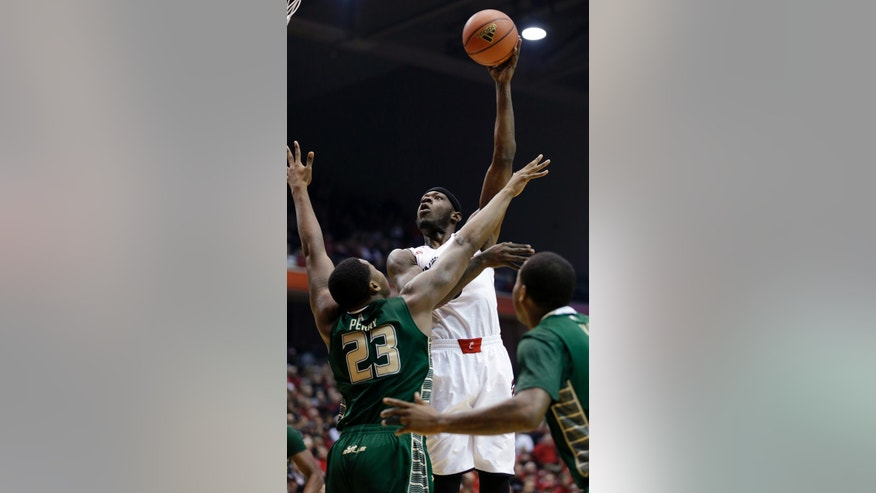 Cincinnati forward Justin Jackson (5) shoots over South Florida forward Chris Perry (23) in the first half of an NCAA college basketball game, Sunday, Feb. 2, 2014, in Cincinnati. (AP Photo/Al Behrman)
