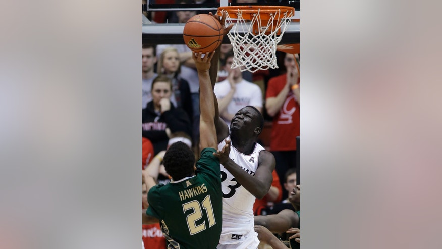 Cincinnati center David Nyarsuk (33) blocks a shot by South Florida guard Javontae Hawkins (21) in the first half of an NCAA college basketball game, Sunday, Feb. 2, 2014, in Cincinnati. (AP Photo/Al Behrman)