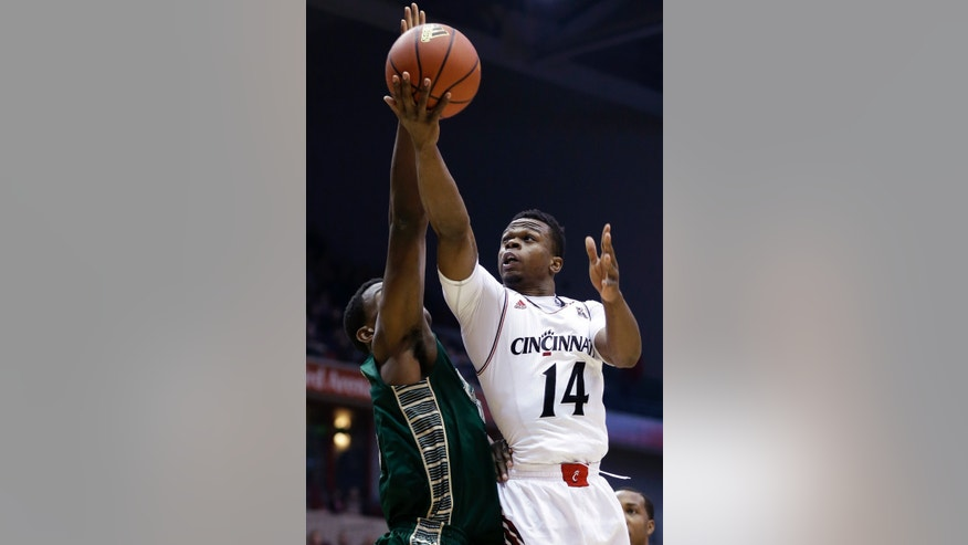 Cincinnati guard Ge'Lawn Guyn (14) drives against South Florida center John Egbunu in the first half of an NCAA college basketball game, Sunday, Feb. 2, 2014, in Cincinnati. (AP Photo/Al Behrman)