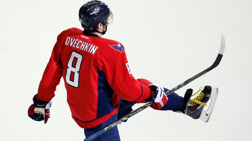 Washington Capitals right wing Alex Ovechkin (8), from Russia, celebrates his game-winning goal in the overtime period of an NHL hockey game against the Detroit Red Wings, Sunday, Feb. 2, 2014, in Washington. The Capitals won 6-5. (AP Photo/Alex Brandon)