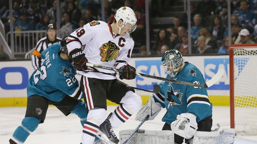 San Jose Sharks goalie Antti Niemi (31), of Finland, blocks a shot against Chicago Blackhawks center Jonathan Toews (19) during the second period of an NHL hockey game in San Jose, Calif., Saturday, Feb. 1, 2014. (AP Photo/Tony Avelar)