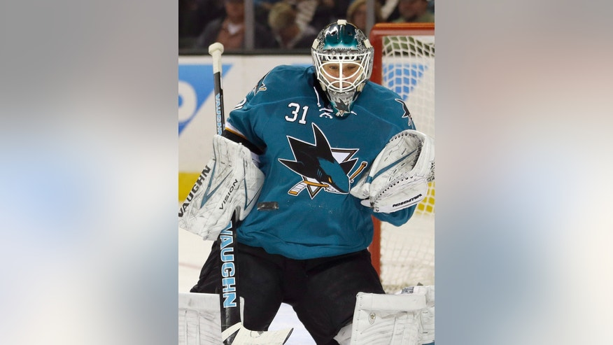 San Jose Sharks goalie Antti Niemi (31), of Finland, blocks a shot against the Chicago Blackhawks during the second period of an NHL hockey game in San Jose, Calif., Saturday, Feb. 1, 2014. (AP Photo/Tony Avelar)
