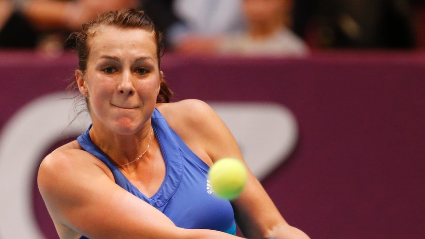 Anastasia Pavlyuchenkova of Russia returns the ball to Sara Errani of Italy during the final match of the 22st Gaz de France WTA Open 2014 tennis tournament at Coubertin stadium in Paris, Sunday Feb. 2, 2014. (AP Photo/Jacques Brinon)
