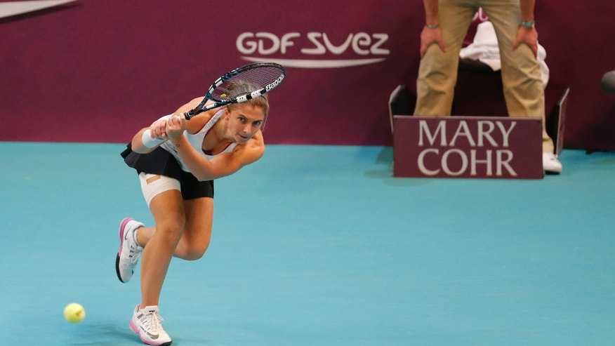 Sara Errani of Italy returns the ball to Anastasia Pavlyuchenkova of Russia during the final match of the 22st Gaz de France WTA Open 2014 tennis tournament at Coubertin stadium, in Paris, Sunday Feb. 2, 2014. (AP Photo/Jacques Brinon)
