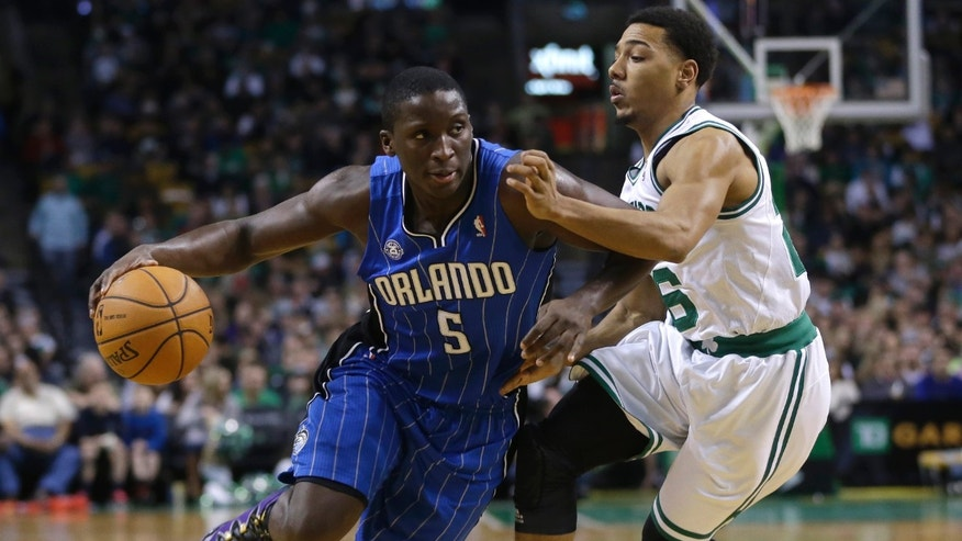 Orlando Magic guard Victor Oladipo (5) drives toward the basket past Boston Celtics guard Phil Pressey, right, in the third quarter of an NBA basketball game on Sunday, Feb. 2, 2014, in Boston. The Celtics won 96-89. (AP Photo/Steven Senne)
