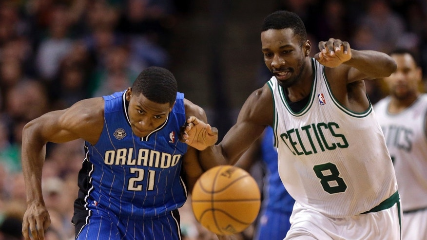 Orlando Magic forward Maurice Harkless (21) and Boston Celtics forward Jeff Green (8) chase a loose ball in the fourth quarter of an NBA basketball game on Sunday, Feb. 2, 2014, in Boston. The Celtics won 96-89. (AP Photo/Steven Senne)