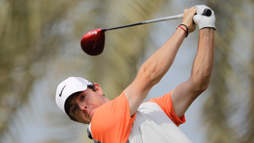 Rory McIlroy of Northern Ireland plays a shot off the 3rd tee during the final round of the Dubai Desert Classic golf tournament in Dubai, United Arab Emirates, Sunday Feb. 2, 2014. (AP Photo/Kamran Jebreili)