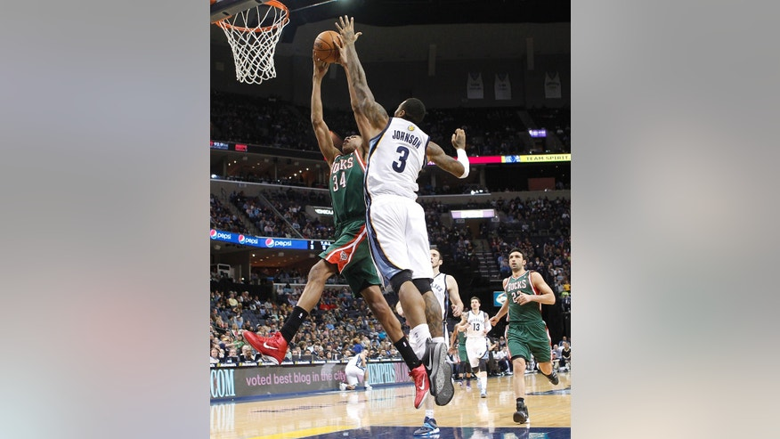 Milwaukee Bucks guard Giannis Antetokounmpo (34) goes to the basket against Memphis Grizzlies forward James Johnson (3) in the first half of an NBA basketball game on Saturday, Feb. 1, 2014, in Memphis, Tenn. (AP Photo/Lance Murphey)